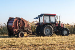 Old tractor standing on the field Royalty Free Stock Photography