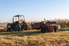 Old tractor standing on the field Royalty Free Stock Photo