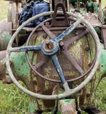 Old Tractor Steering Wheels. Two old vintage tractor steel sterring wheels royalty free stock photo