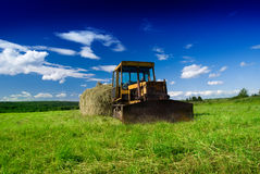 Old tractor and summer day Stock Photo