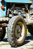 Old tractor tire and engine Stock Image