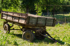 Old tractor trailer. An old tractor trailer is in the backyard of a farm Royalty Free Stock Image