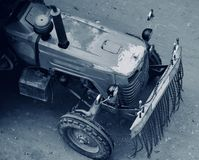 An old tractor vehicles running on the Indian streets. An old tractor vehicles running on the streets around the south region in India isolated unique stock stock photos