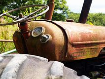 Old tractor. Vintage Tractor rusting away in field Stock Images
