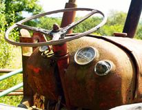Old tractor. Vintage Tractor rusting away in field Royalty Free Stock Images