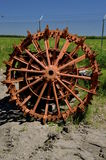 Old tractor wheel with lugs. A huge and heavy industrial wheel for a large old tractor uses lugs for traction rather than tires Royalty Free Stock Images