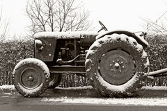Old tractor in winter Stock Images