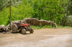 Old tractor and woods Royalty Free Stock Photography