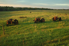 Old tractors. Antique tractors left to rust in a pasture in Iowa Stock Images
