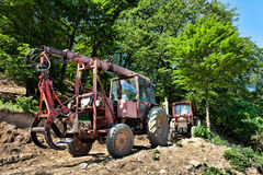 Old tractors. Extraction of logs from the forest Stock Image
