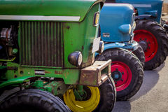 Old tractors. Lined up next to each other Stock Image
