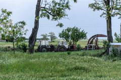 Old tractors in the field. Tractors. Old tractors in the field at sunset of the day Royalty Free Stock Photos