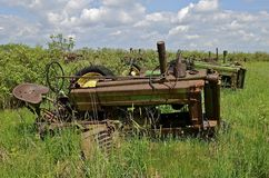 Old Tractors left for salvage junk, and parts. Old tractors with missing parts are left in a salvage and parts junkyard Royalty Free Stock Photo