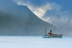 Old tradition boat floating in wakatipu lake queen town south is Royalty Free Stock Image
