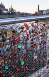 Old tradition of sealing a couple`s initial names inscribed padlock with the popular bridge and tossing the key into the river royalty free stock photo