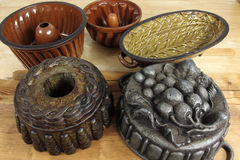 Baking form. Old traditional  baking pans and moulds for cake Royalty Free Stock Photo