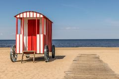 Old traditional beach hut changing room on the beach. royalty free stock photography