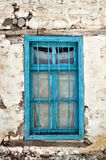 Old traditional blue window. Old traditional blue weathered window in northern Greece Royalty Free Stock Photography