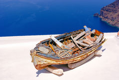 Old traditional boat on terrace, Santorini island Royalty Free Stock Photo