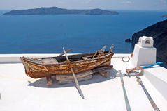 Old traditional boat on terrace, Santorini island Stock Images