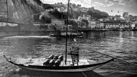 Old traditional boats with wine barrels, Porto. Royalty Free Stock Photo