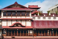 An old traditional building on the side of Kamo River, Kyoto, Japan. Kyoto, Japan -November 2, 2018: An old traditional building on the side of Kamo River with stock photos
