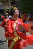 Old traditional Chinese dancer performs. Old traditional Chinese dancer in red costume performs Royalty Free Stock Photos