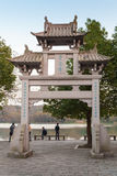 Old traditional Chinese stone gate on coast on West Lake Royalty Free Stock Photo