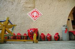 Old traditional Chinese wine brewery. With red stone storages Royalty Free Stock Images