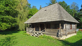 Old traditional cottage. Architectural style of  a Romanian cottage with yard in Gorj region. Wood house with 3 rooms and a veranda, constructed around year 1850 Royalty Free Stock Photos