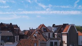 Old traditional Dutch city rooftops on a clear blue sky. Leiden The Netherlands Stock Photos