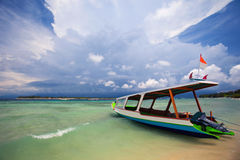Old traditional fishing boats at the beach. Bali, Indonesia. Old traditional fishing boats on the beach on the background of storm clouds. Bali, Indonesia Royalty Free Stock Images