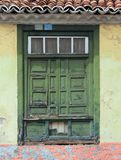 Old traditional green painted window with closed shutters Royalty Free Stock Images