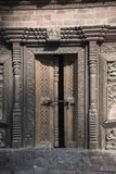 Old traditional handcrafted wooden door royalty free stock photo