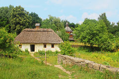 Old traditional house and church in Ukraine Stock Images