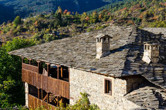 Old traditional house in Kovachevitza, Bulgaria. Autumnal scene and stone roof of old traditional house in ethnographic reserve of Kovachevitza, Bulgaria Royalty Free Stock Image
