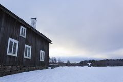 Old - traditional - house in rural sweden and a wintery landscape on a beautiful winters day. Old - traditional - house in rural sweden and a wintery landscape Royalty Free Stock Photo