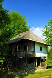 Old traditional house in a village museum. Beautiful nature spot with traditional old wooden house Royalty Free Stock Photo