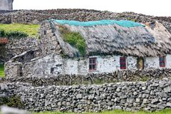 Old traditional Irish house, Inisheer, Ireland. Traditional stone house with thatched roof, Inis Oirr, Aran Island, Ireland Stock Photography