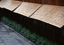 Old and traditional Japanese continued bamboo wall background stock image
