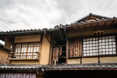Old Traditional Japanese House in Gion, Kyoto, Japan. Old traditional Japanese house detail with the specific roof tiles on a vintage street in Gion District royalty free stock photos
