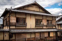 Old traditional Japanese house of historical value in Gion, Kyoto. Old traditional Japanese house of historical value with the specific roof tiles on a street royalty free stock photography