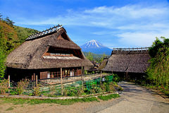 Old traditional Japanese Houses and Mount Fuji. Old style traditional houses in the village of Saiko Iyashi no sato nenba near Mount Fuji royalty free stock image