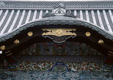 Old traditional Japanese wood and gold decoration of entrance background. Old traditional Japanese wood and gold decoration of entrance royalty free stock photography