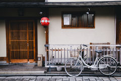 Old traditional japanese wooden architecture and bicycle in Kyoto, Japan Royalty Free Stock Photos