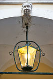 Old traditional lantern with marble bust Royalty Free Stock Photo