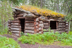 Old traditional log cabin rotting in Yukon taiga Stock Photos