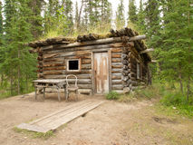 Old traditional log cabin rotting in Yukon taiga Stock Photography
