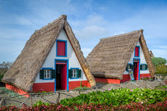 Old traditional Madeira explorer's houses - the symbol of island Stock Photos