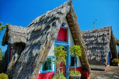 Tropical hut by the sea, Madeira. Old traditional Madeira hut with characteristic triangle thatched roof royalty free stock images